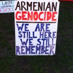 One of the many signs advocating recognition of the mass killings as 'genocide'